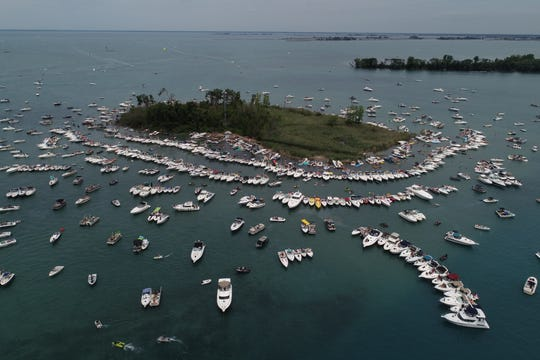 By early afternoon Gull Island has attracted quite a crowd of pleasure boats in the middle of Lake St. Clair for the annual Jobbie Nooner boat party despite the threat of exposure to coronavirus on Friday, June 26, 2020.