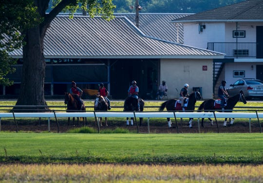 Exercise riders rest under a tree near the stables at Ellis Park Wednesday morning, June 24, 2020.