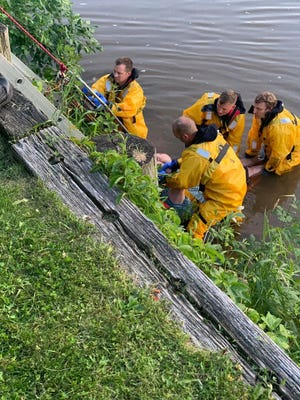 A crew from Fond du Lac Fire & Rescue rescues a man from the Fond du Lac Thursday.