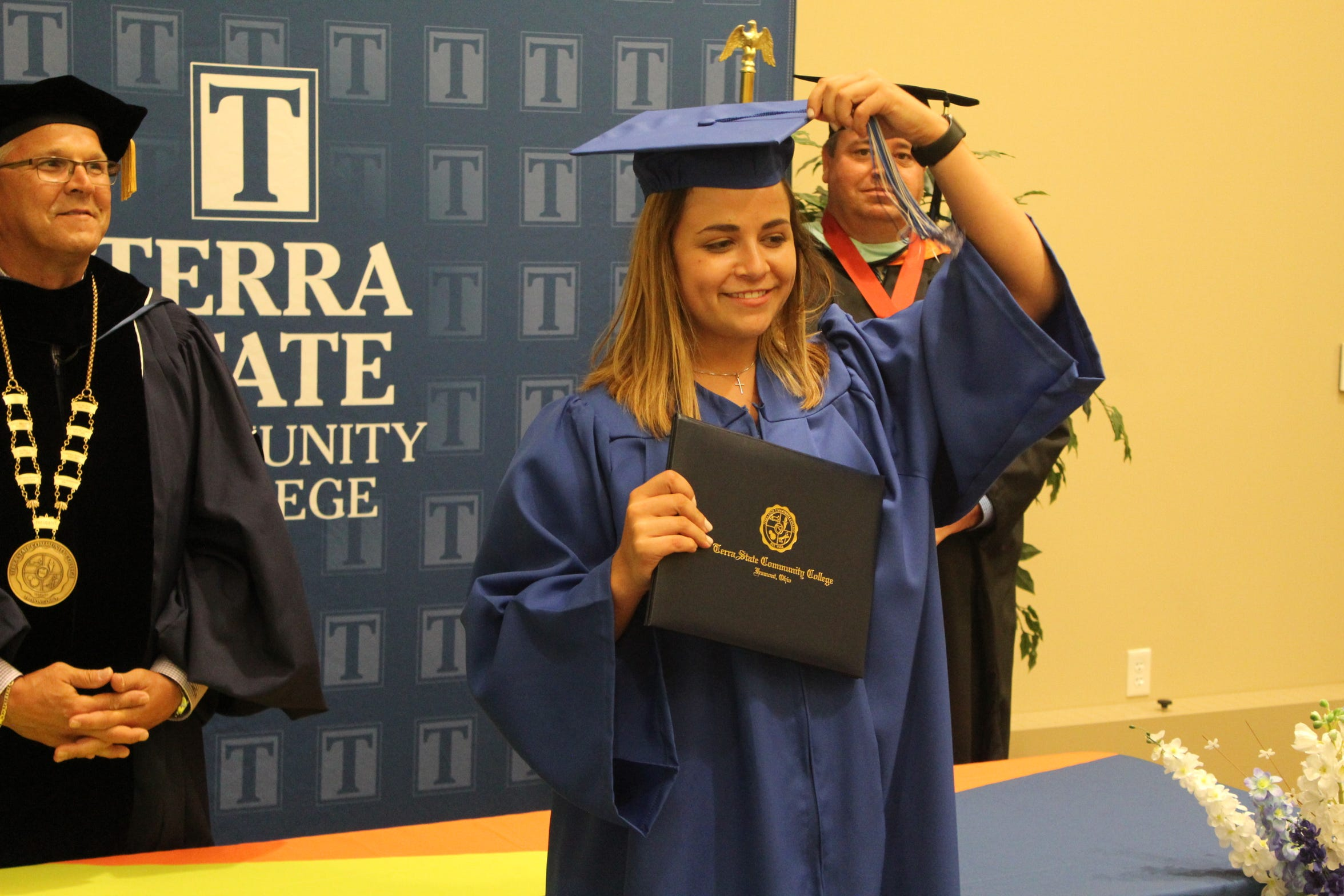 Leah Liskai of Woodville turns the tassel on her graduation cap after receiving her associate's degree in agribusiness management Thursday at Terra State Community College.