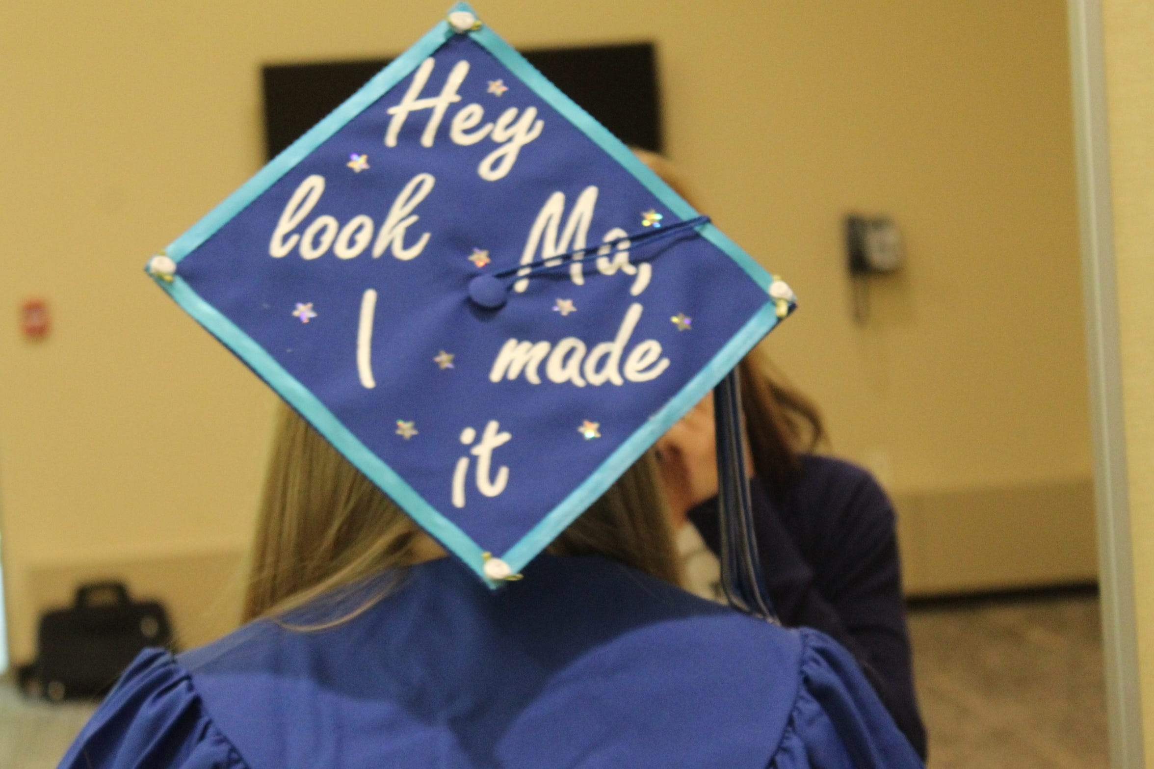 Aubrey Stanforth of Tiffin decorated her Terra State Community College graduation cap with the title of a Panic at the Disco song Thursday. Stanforth was awarded an associate's degree in psychology.
