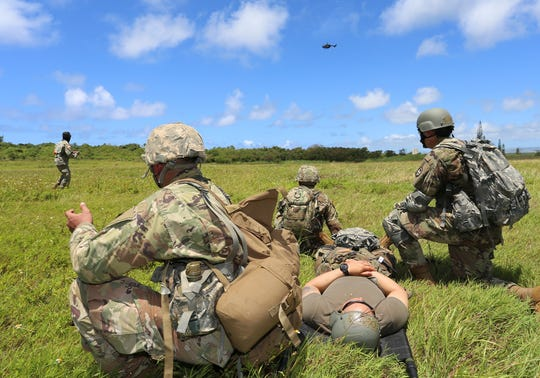 Officer candidates from the Guam National Guard and ROTC Cadets from the University of Guam train together in Barrigada in this June 17 file photo. The joint exercises were the first coordinated training effort between the two commissioning sources in over 10 years.