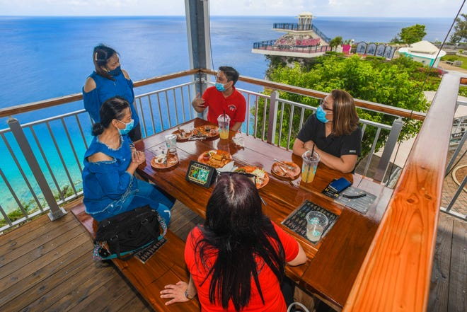 Co-workers form Primary Pediatric Care clinic enjoy a midday meal while dining at the Terraza Dos Amantes restaurant within the Puntan Dos Amantes, or Two Lovers' Point, scenic attraction on Friday, June 26, 2020.