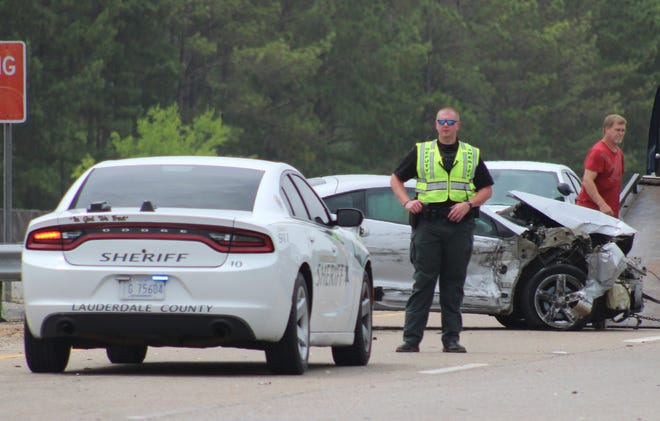A sheriff's deputy guards the scene of a car crash on State Highway 145 in Lauderdale County, Miss. on Thursday, June 25, 2020. A man who escaped from a jail in Washington County, Ala., and stole the car was captured after a chase through Wayne and Clarke counties, authorities said. (Bill Graham/The Meridian Star via AP)