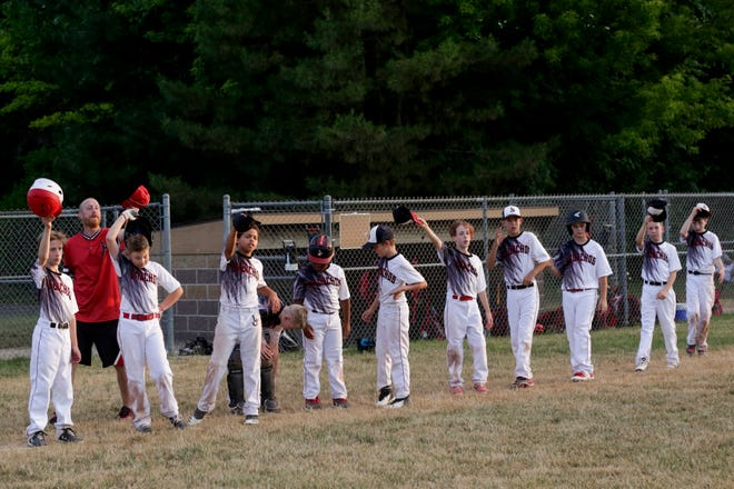 Lafayette Junior Broncho players tip their cap to Harrison following an 11U baseball game at Armstrong Park. The gesture has replaced postgame handshakes.