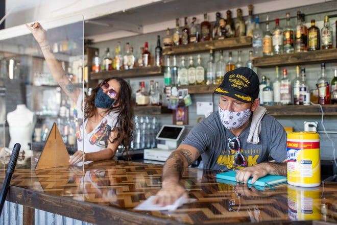 Natasha Sud, left, and Gerald Dickerson with Shop Bar work on prepping the Barrett Avenue establishment Thursday as they prepare for reopening. June 25, 2020