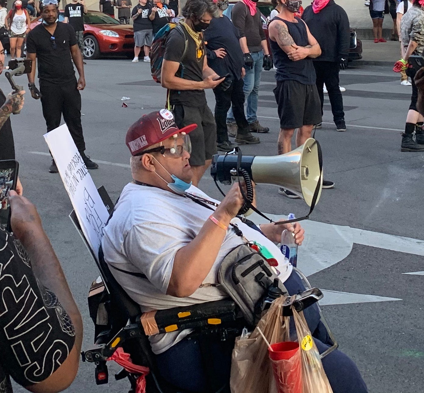 """Ronnie Hogan is known by other protesters for his friendly demeanor and the sign he brings downtown each day with the message: """"Stand for something or you'll fall for anything."""""""