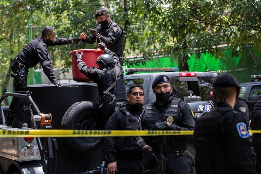 """Police cordoned off an area of where an assassination attempt was made on Mexico City's police chief. Officials have blamed Cártel Jalisco Nueva Generación (CJNG) and its fugitive leader, """"El Mencho."""""""