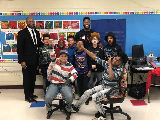 Former Marion Harding High School football standout LJ Scott, back row, center, was the speaker for the George Washington Elementary School Harambee group earlier this year. Marion City Schools Equity and Diversity Supervisor Johnnie Jackson, left, said he tries to provide a variety of cultural and educational experiences for students in the Harambee groups.