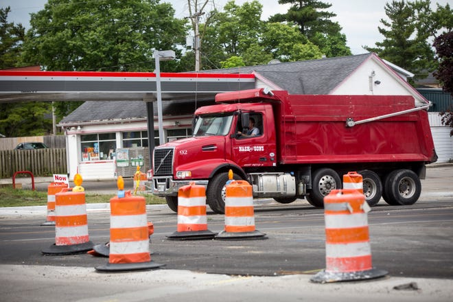 Cars and construction traffic move through the Centennial Avenue intersection with Wheeling Avenue on Friday afternoon. That section of Centennial will be closed Monday, June 29 for 45 days for the Wheeling expansion project.