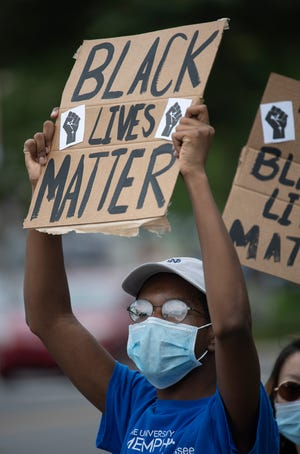 Marvin Brown hold a sign during a Black Lives Matter protest along Franklin Rd.  Friday, June 26, 2020 in Brentwood, Tenn.