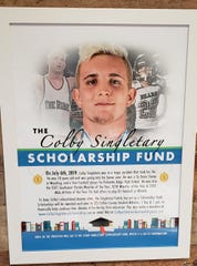 A poster for the Colby Singletary Scholarship Fund hangs on the wall of Nana's Diner in Golden Gate, where the family of the late wrestler announced winners of scholarships in his name Thursday, June 25, 2020.