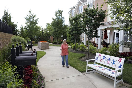 Jane Vanover walks along the destination stations outside of the Senior Star's memory wing at the Dublin Retirement Village in Dublin, Ohio on June 25, 2020.  The outdoor destination stations help their cognitive abilities improve after the inside destinations were closed because of the pandemic.