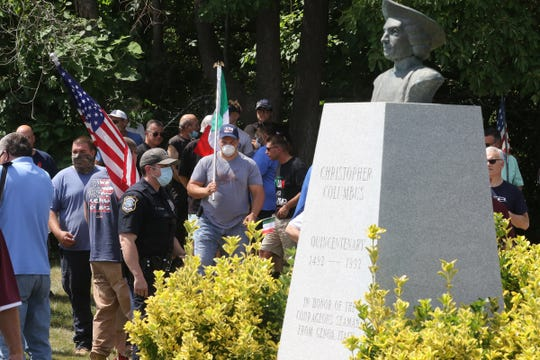 Citizens staged a demonstration on Rt. 46 in support of a protecting a bust of Christopher Columbus that stands outside the Parsippany municipal building. A group opposing the monument gathered on the same grounds and each group debated one another.