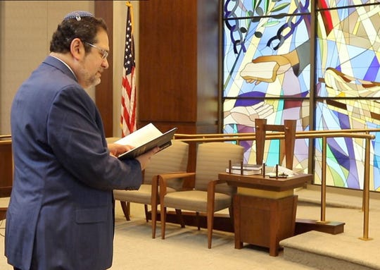 Rabbi Jordan Millstein prays at Temple Sinai in Tenafly on June 26, 2020 where he spoke about his commitment to fight racism.