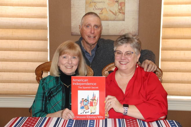 Front, left to right, seated, Barbara Middleton-Wiley and Liz Duffy-Strasser, and Alvin R. Wiley, illustrator