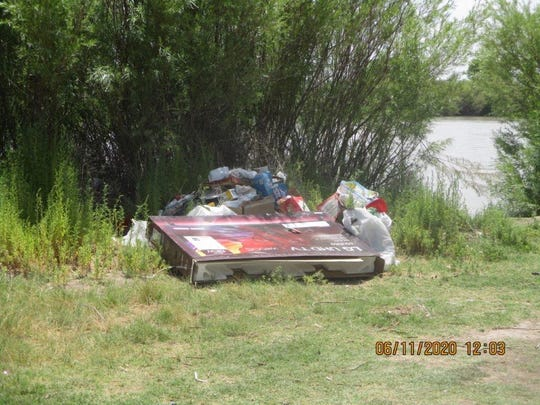 Doña Ana County codes officers respond to an illegal dump site along the Rio Grande on June 11, 2020.