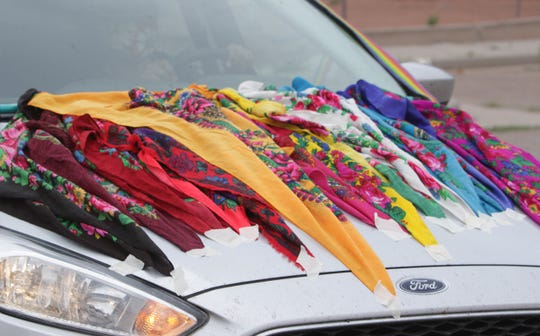 A rainbow of scarves decorates a car in the Diné Pride Cruise on June 26 in Window Rock, Arizona.