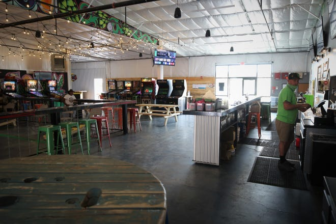 The Lauter Haus Brewing Co. in Farmington is welcoming customers back inside, but its owner says many people appear reluctant to begin socializing again as fears of COVID-19 linger.