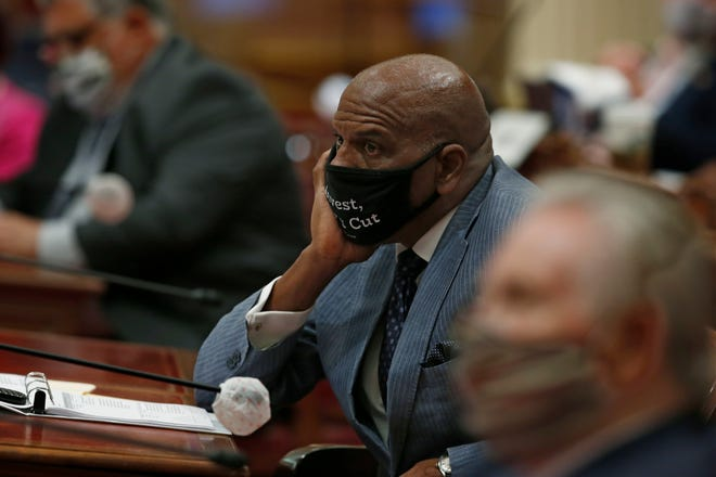 State Sen. Steven Bradford, D-Gardena, listens as lawmakers discuss a bill before the Senate at the Capitol, in Sacramento, Calif., Thursday, June 25, 2020. The Senate is expected to vote on Thursday, on a state budget plan that has the backing of both Gov. Gavin Newsom and Democratic Legislative leaders.
