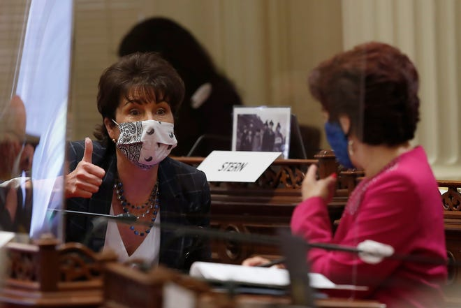 State Sen. Connie Leyva, D-Chino, talks with Sen. Anna Caballero, D-Salinas, at the Capitol in Sacramento on June 25, 2020. The facility is being deep cleaned after members of the Assembly and staffers contracted COVID-19.