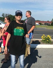 """Donna Gathright of Richland wearing a shirt reading """"COVID 19 State Champs"""""""