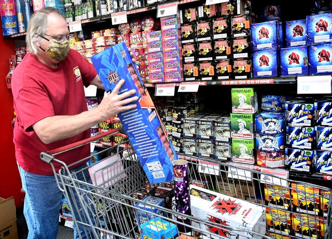 """Steve Smith of Tappahannock, Va. loads fireworks at Big Fireworks in Glen Rock Thursday, June 25, 2020. He spent more than his usual $500 for his holiday fireworks show. """"My daughter just graduated so I have to do something extra for her,"""" he said. Big Fireworks manager Leslie Wilson estimates sales there are about 4 to 5 times more than the previous year since many municipalities have canceled fireworks due to COVID-19 restrictions this year. Bill Kalina photo"""