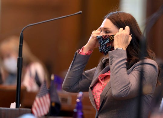 Sen. Shemia Fagan, D-Portland, adjust her mask during a special session in the Oregon State Capitol in Salem, Oregon, on Friday, June 26, 2020.