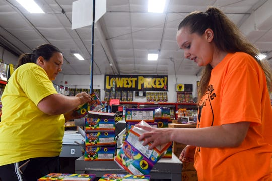 Pyro City Fireworks employees Angie Temme and Brittany Ugofsky prepare products for in-state sales to begin on Friday, June 26, in Sioux Falls.