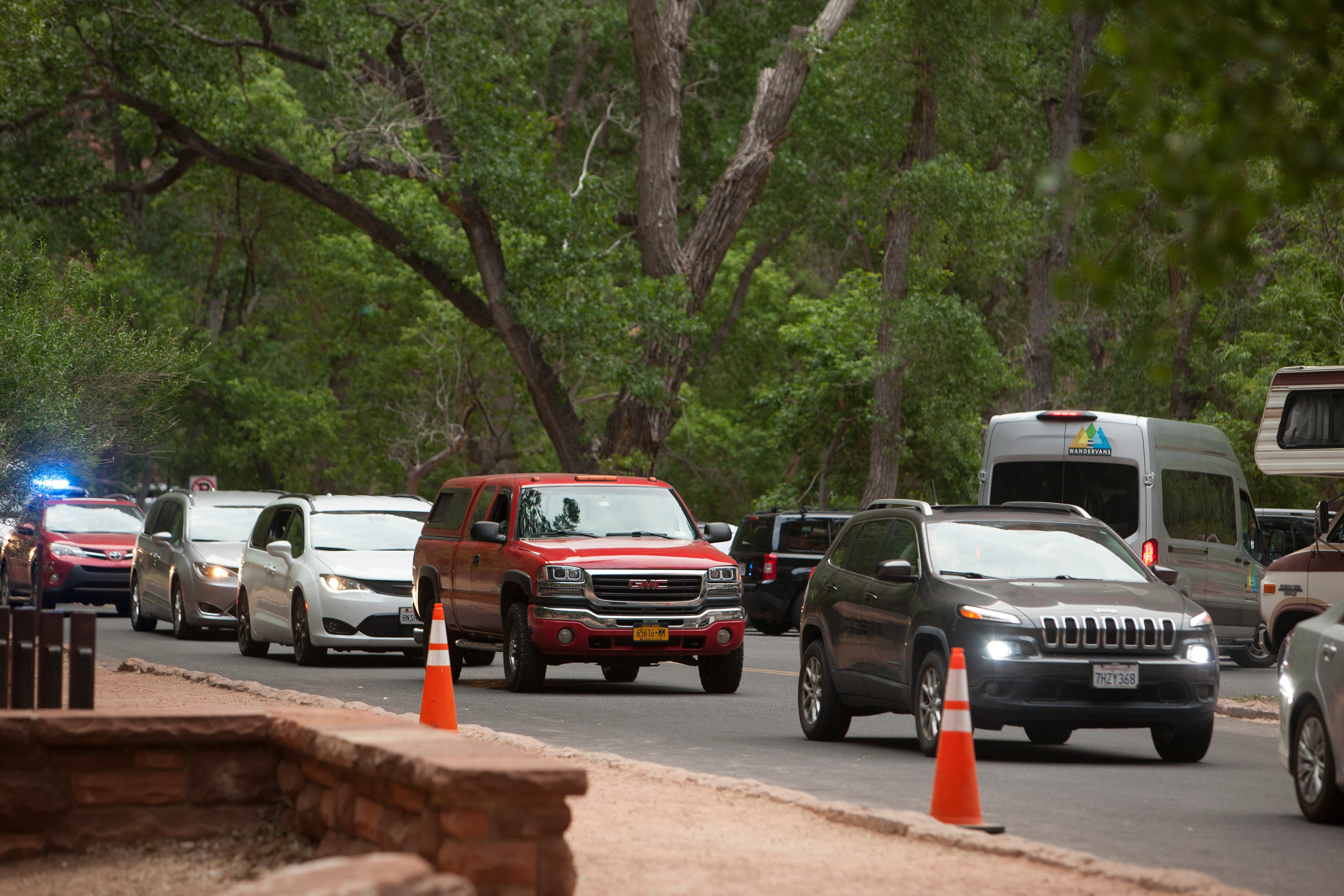 Hundreds of cars line up in Zion National Park every morning in hopes to get a parking spot at one of the popular trailheads.