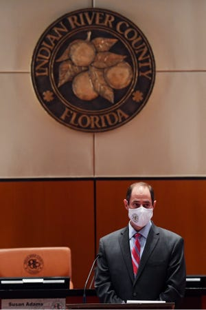 Indian River County Administrator Jason Brown address a small group of media and citizens concerning the required use of face makes on Friday, June 26, 2020, in the County Commission chambers in Vero Beach.
