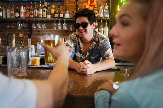 Rockin' Cigar Bar & Grill bartender Frankie Ricci III helps run his dad's bar after his dad, Frank Ricci Jr., refused to shut down the bar Friday, June 26, in El Paso after Gov. Greg Abbott ordered bars to once again close throughout Texas. The order required bars to close at noon.