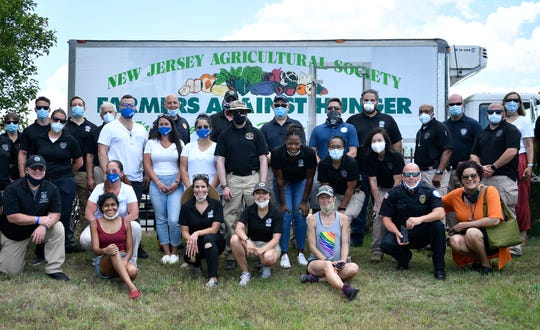 A Farmers Against Hunger free produce distribution event took place at the Save-A-Lot parking lot in Millville. Boxes of mixed vegetables were handed out to families in need on Friday, June 26, 2020.