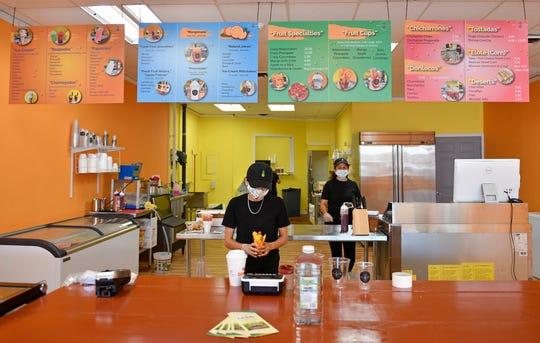 Betzaveth Cruz, owner of Fruta Mex on East Landis Avenue in Vineland, prepares a fruit cup on Friday, June 26, 2020.