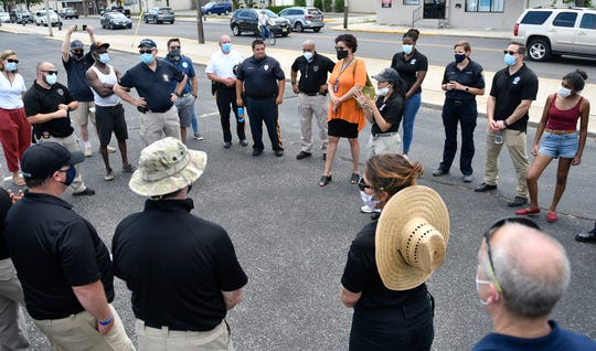 Left center, Cumberland County Prosecutor Jennifer Webb-McRae and Director of N.J. Division of Criminal Justice Office Veronica Allende, right, thank volunteers following Friday's free produce distribution event in Millville.