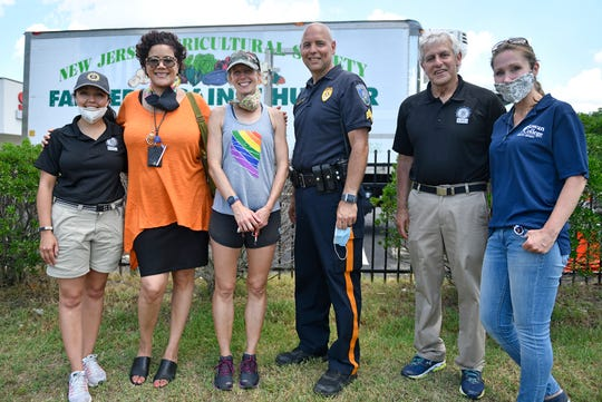 Left to right, Director of N.J. Division of Criminal Justice Office Veronica Allende, Cumberland County Prosecutor Jennifer Webb-McRae, Elyse Yerrapathruni of Farmers Against Hunger, Millville Police Sgt. Rick Kott, N.J. Special Investigator with Division of Criminal Justice David S. Leonardis and Rowan College of N.J. Professor Dr. Kate Tumelty Felice pose for a photo following a free produce distribution event in Millville on riday, June 26, 2020.