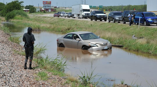 Emergency personnel responded to a water rescue around 1 p.m. Friday. All passengers escaped the vehicle and there were no injuries.
