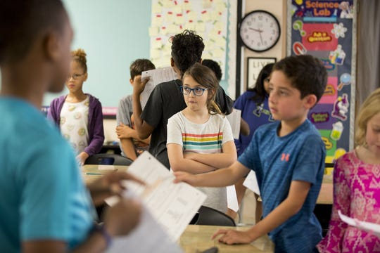 Talia Wilhelm, 10, participates in an activity where fourth graders learned about the functions of the family as part of their human sexuality and responsibility curriculum at Gullett Elementary School on May 16, 2019, in Austin, Texas. AISD is expected to have a new curriculum in June that will teach students more age appropriate lessons.