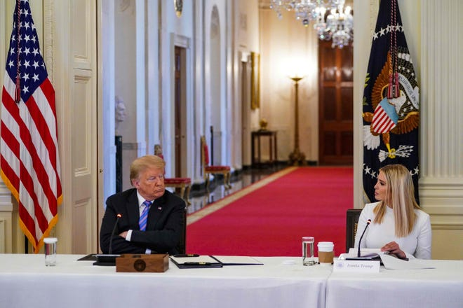 President Donald Trump and his daughter and advisor Ivanka Trump (R) attend an American Workforce Policy Advisory Board Meeting in the East Room of the White House on June 26, 2020.