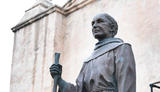 A statue of Father Junipero Serra is seen in front of the San Gabriel Mission in San Gabriel, California on June 21, 2020. - Serra, recognized as one of the most important Spanish missionaries and one of the founding priests of the San Gabriel Mission in 1771, the first of nine missions across California, was canonized by Pope Francis in 2015 but remains a controversial figure especially by California's Native Americans who accuse him of destroying their culture and tribes. (Photo by Frederic J. BROWN / AFP)