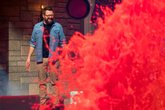 "'Floor Is Lava"" host Rutledge Wood watches a spurting molten fountain of red on the show's jaw-dropping set."