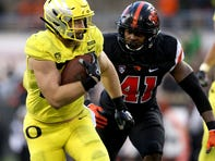 Oregon's Ryan Bay (87) rushes  past Oregon State's Shemar Smith (41) in the Oregon vs. Oregon State Civil war football game at Oregon State University in Corvallis on Friday, Nov. 23, 2018. The Ducks won the game 55-15.  Civilwar Ar 46