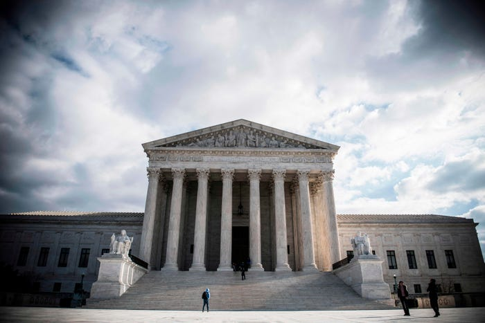 Pandemic postponements keep Supreme Court toiling into July