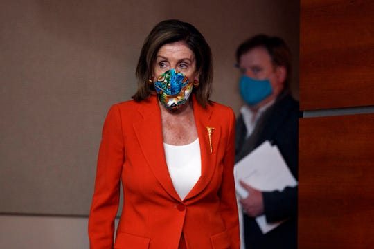House Speaker Nancy Pelosi of Calif., wears a face mask as she arrives to speak at a news conference on Capitol Hill in Washington, Friday, June 26, 2020.