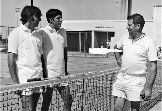 Sweetwater tennis coach Fred L. Scott, right, talks to his son, Fred. W. Scott, and Mike Boles during practice. The younger Scott and Boles won a state title in boys doubles in 1972.