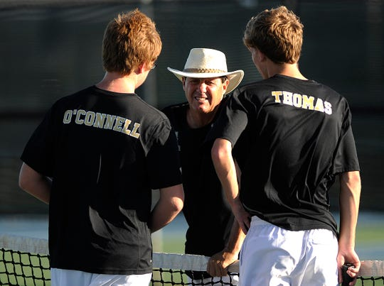 Abilene High head coach Fred Scott (center) talks with doubles players Nick O'Connell and JT Thomas between sets during their doubles match against Cooper on Tuesday, Oct. 16, 2012, at Cooper High School.