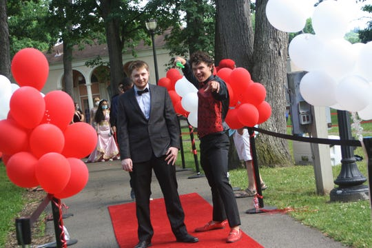 Binghamton High School hosted Red Carpet Pics in the Park at Recreation Park on June 26, 2020. Students dressed as formal or casual as they wished, with many choosing to wear traditional prom looks complete with a corsage and boutineer. In an effort to keep capacities down and maintain social distancing, students were given specific times to arrive at the park. All students wore masks but were able to remove them once they entered the red carpet for a photo shoot. Individuals and couples took photos one at a time on a red carpet and under the bandstand. The event was followed by a virtual prom in the evening.