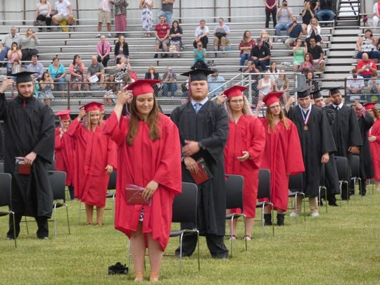 Members of the Bucyrus High School Class of 2020 prepare to move their tassels during their graduation ceremony Friday night.