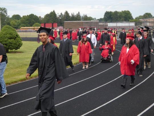 Classmates enter Bucyrus Redman Stadium as the Bucyrus High School Class of 2020 graduates Friday night.