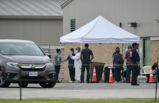 The National Guard facilitates COVID-19 testing in Robstown, Saturday, June 27, 2020. People lined up for testing since 5 a.m.